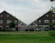14 woningen op rij in Groningen
